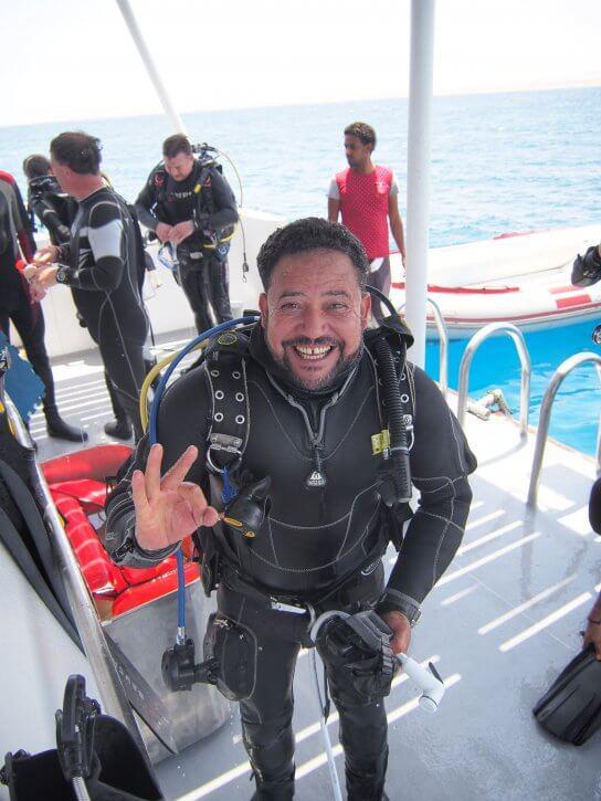 Yasser, a happy dive guide onboard hurricane.